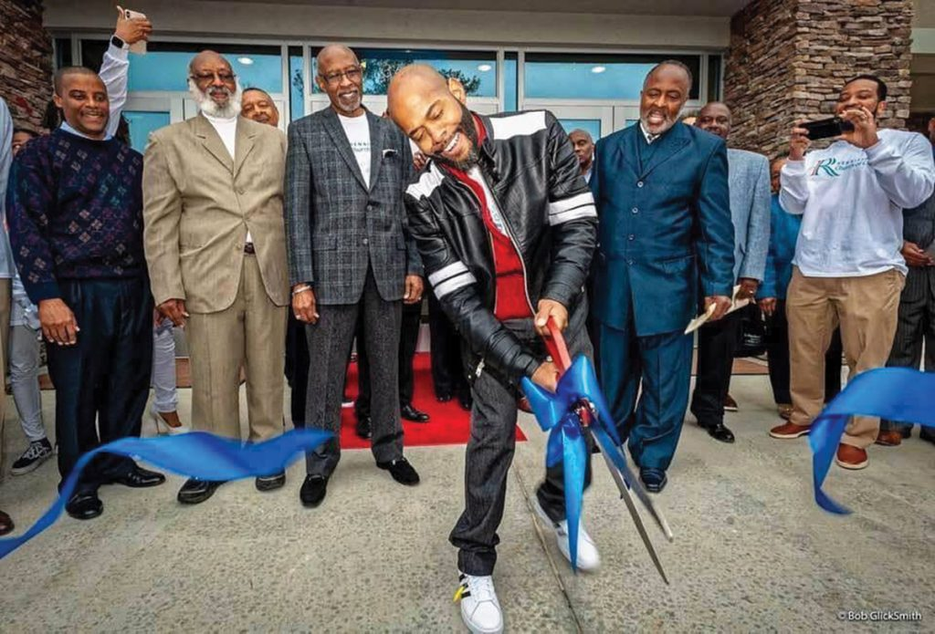 Minister Orpheus Heyward cuts a ribbon at a building dedication for the Renaissance Church of Christ in Atlanta, financed by The Solomon Foundation.