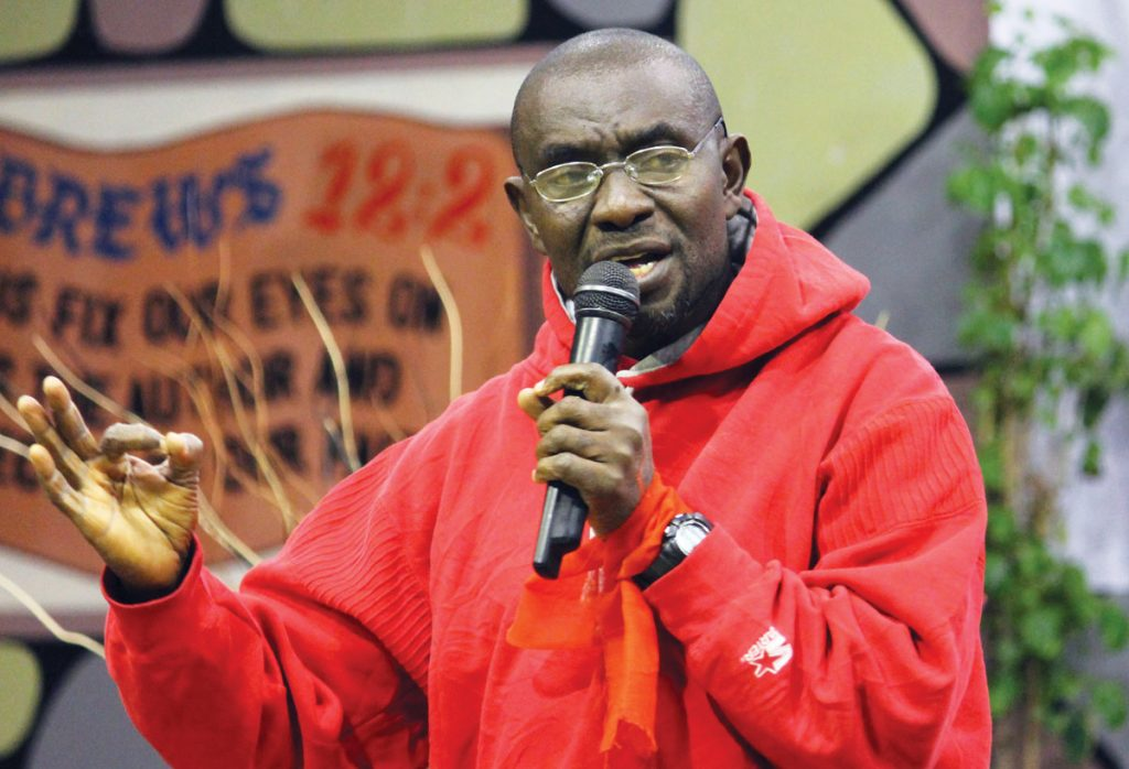 Isaac Adotey speaks at the 2012 Africans Claiming Africa for Christ conference in Lusaka, Zambia. His baggage was delayed, so he addressed the conference in a hoodie and jeans.