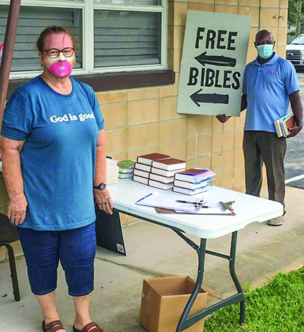 Members Connie Halladay and Idelet Dessin share God's written word at the PIne Castle Church of Christ in Orlando, Fla.