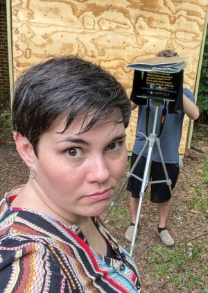 Celeste Smith playfully reacts as her minister husband, Steven, makes yet another video for their congregation in their hot, humid backyard in East Texas.