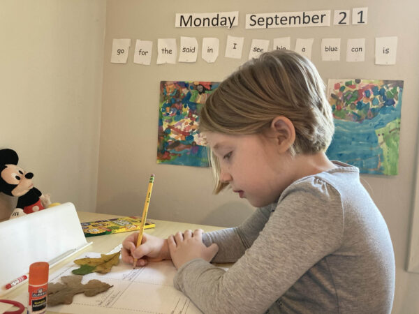 Chellie's daughter, Ila, works on her Kindergarten work from home.