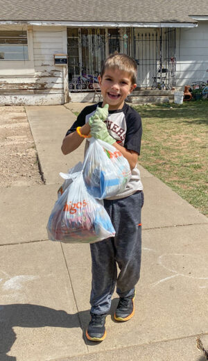 Young volunteers help deliver food as part of the program.
