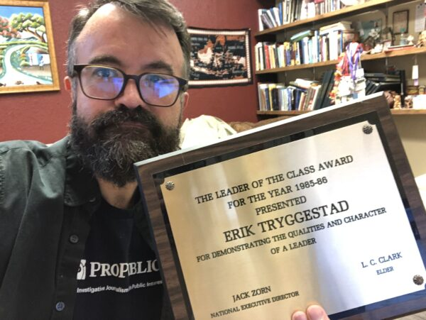Erik Tryggestad shows off his Leader of the Class award from the mid-1980s.