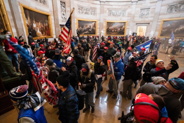 Supporters of President Donald Trump mob the Capitol Rotunda after breaching security during the Jan. 6 riot.