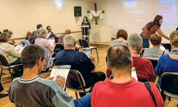 Church members and visitors meet for Wednesday night discussion groups.