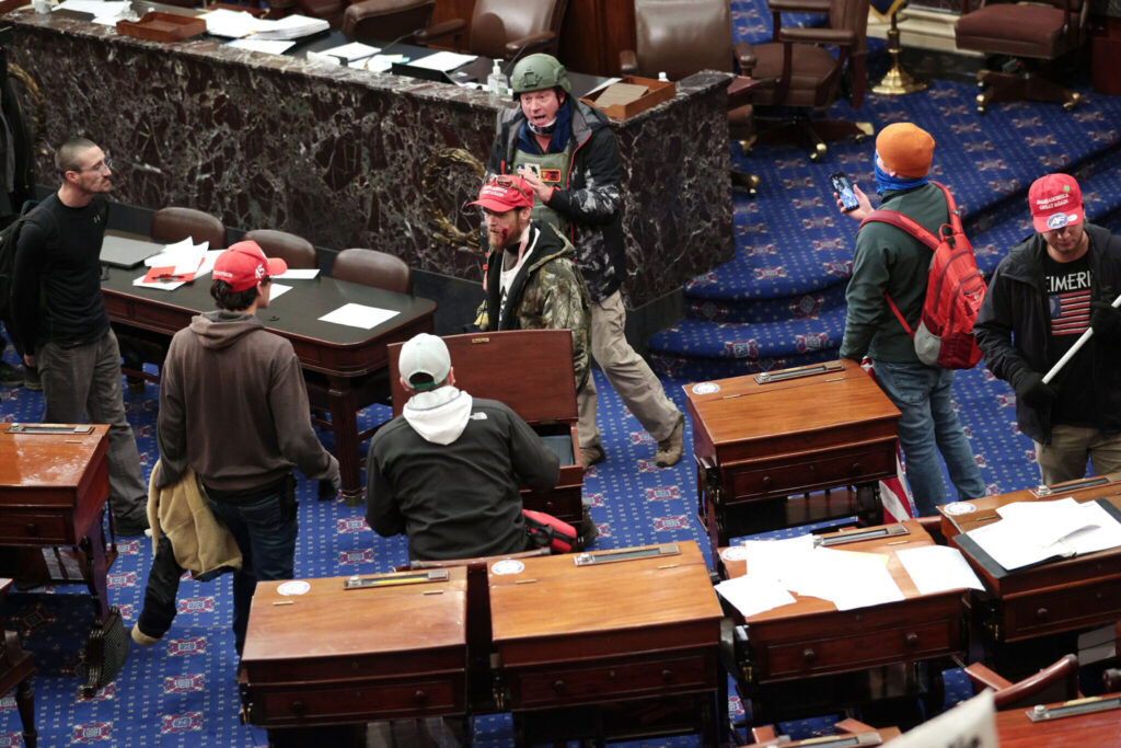 Rioters are shown on the floor of the U.S. Senate.