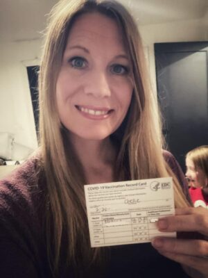 Chellie Ison with her vaccine card after receiving her first Moderna dose.