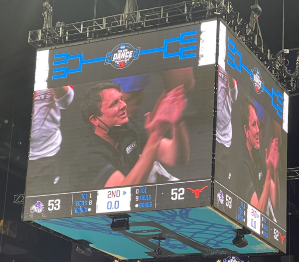 The scoreboard at Lucas Oil Stadium in Indianapolis shows ACU coach Joe Golding celebrating his team's 53-52 upset of Texas.