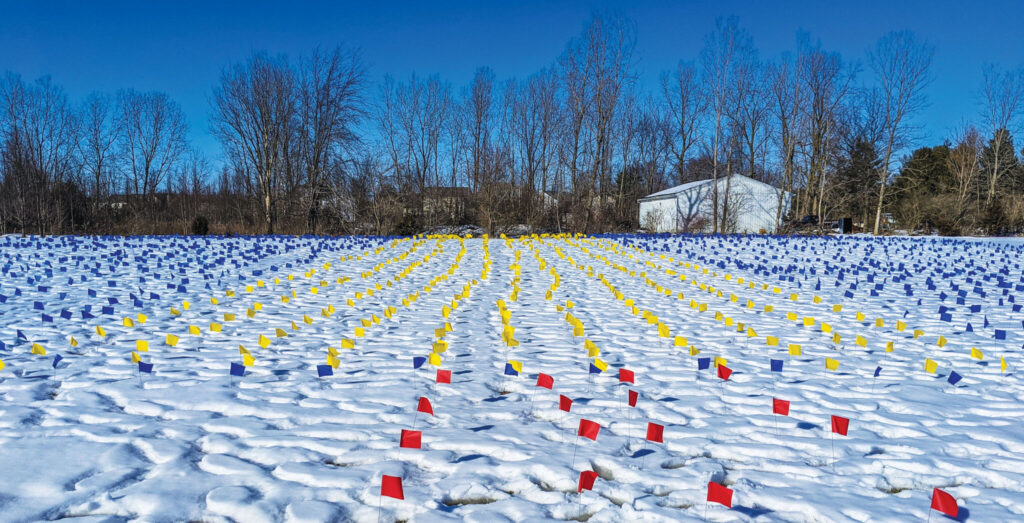 Flags cover the snowy ground outside the Alum Creek Church of Christ in Lewis Center, Ohio, in memory of the millions who have died from COVID-19.
