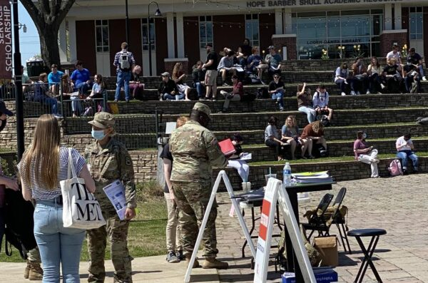 Students at Freed-Hardeman University in Henderson, Tenn., gather as vaccines for COVID-19 are given on the Christian campus.
