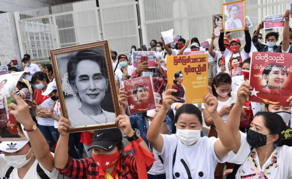 Myanmar protesters in Thailand rally in front of the United Nations facility in Bangkok.