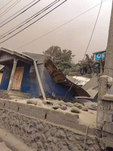 Ash covers the collapsed meeting place of the Sandy Bay Church of Christ in St. Vincent.