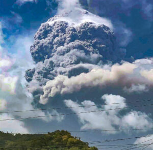 "The stratovolcano La Soufriere (French for ""sulfurous"") shoots ash thousands of feet above St. Vincent."
