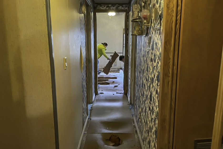 Members of the RiverHawks for Christ ministry in Oklahoma removed waterlogged floorboards from a flood-damaged home in eastern Kentucky.