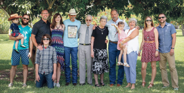 Shown are grandson Joshua Rees, holding great-grandson Elijah Rees; grandson Keith Doyle; great-grandson Caleb Doyle; great-granddaughter Taryn Doyle; son Larry Doyle; Dale and Fern; son Jimmy Doyle; daughter Cheryl Doyle, with great-granddaughter Luna Rees, granddaughter Carra Doyle; and grandson David Doyle.