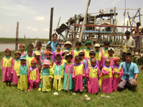 School children in Myanmar show off the ponchos they received from Partners in Progress.
