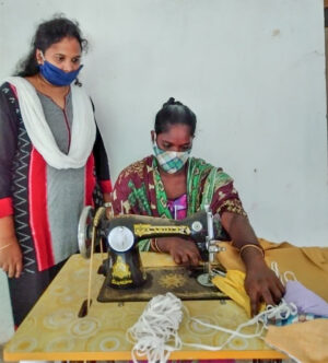 Sonia Madiki, left, teaches women to sew (and make masks) in southern India.