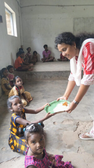 Sonia Madiki feeds children in the midst of the COVID-19 pandemic in southern India.