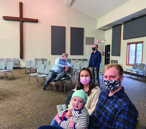 Caleb, Taylor and Axel McCaughan observe social distancing at the Woodbury church.