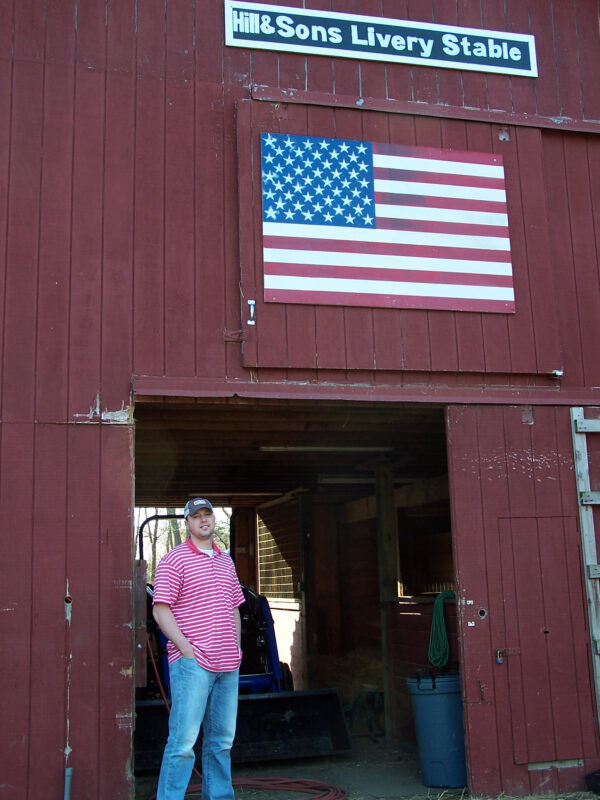 James Hill stands outside barn at the Timothy Hill Children's Ranch in Riverhead, N.Y.