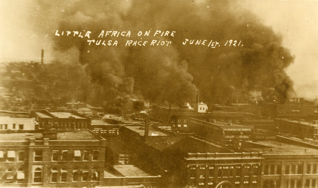 The Greenwood District burns during the Tulsa Race Massacre of 1921.