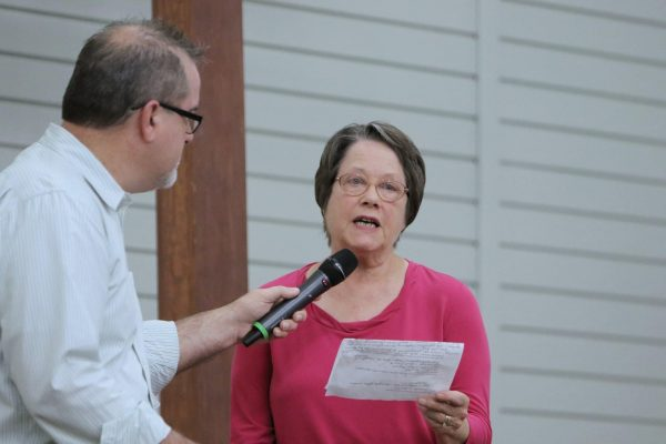 Glenda Tate is interviewed during a worship service at South Baton Rouge Church of Christ by Lance Hendrix, a church elder.