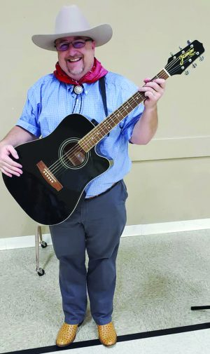 Clyde Slimp, minister for the Westhill Church of Christ in Cleburne, Texas, enjoys singing and songwriting.