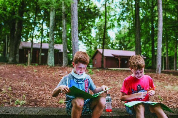 Two campers study their Bible lessons at Carolina Bible Camp.