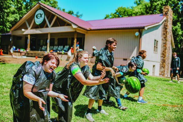 Campers enjoy a watermelon toss at Carolina Bible Camp.