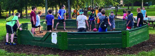 Campers engage in a spirited round of gaga ball at Carolina Bible Camp.