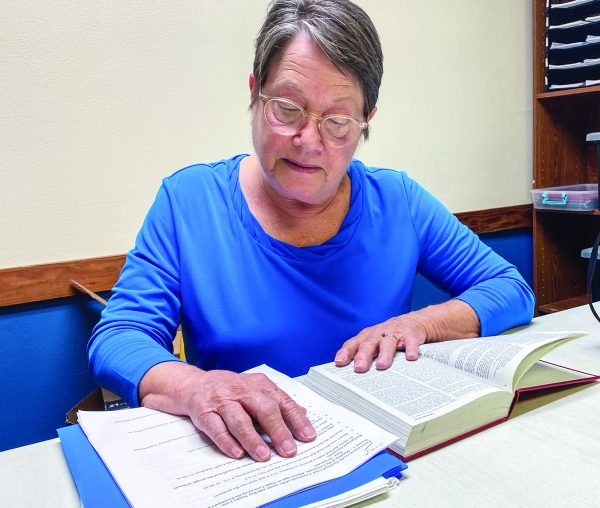 Glenda Tate reviews one of the Bible lessons she shares with inmates.