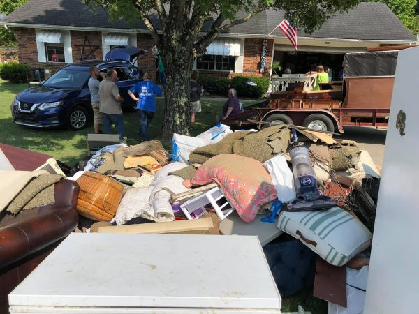 The elders at Rolling Hills Church of Christ assist with flood cleanup.