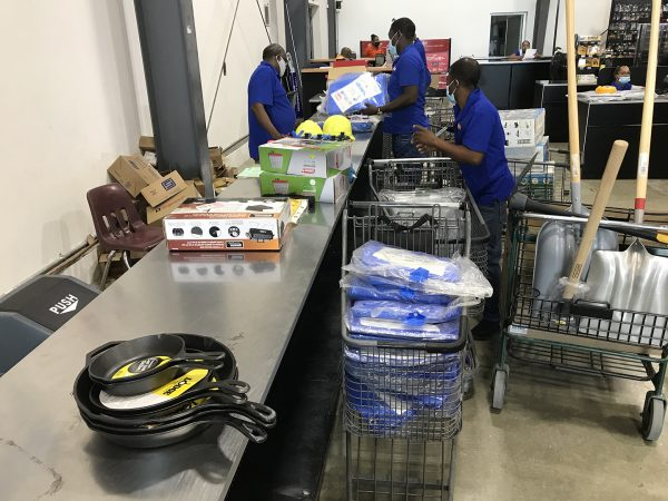 Workers with Hope for Haiti's Children gather supplies for earthquake relief.