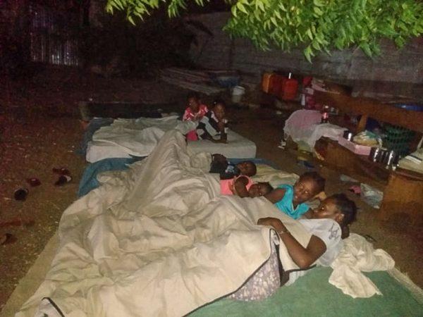 Haitians sleep outdoors after a 7.2-magnitude earthquake.