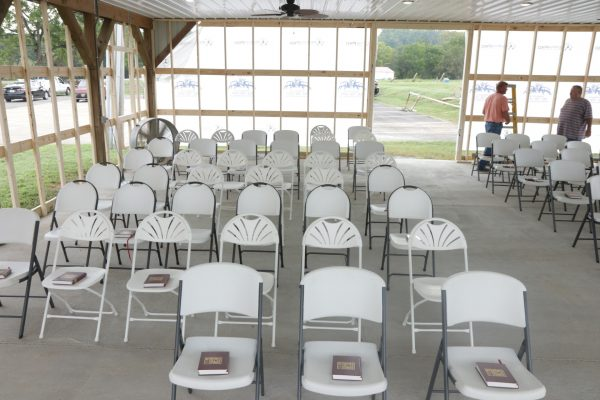 New songbooks sit on the folding chairs in the makeshift worship facility.