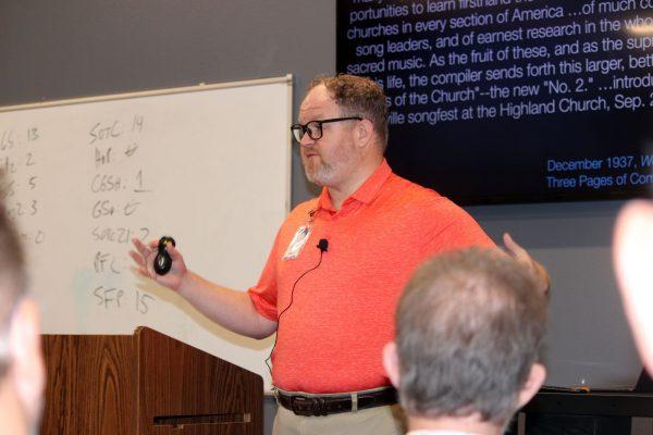 Hymnologist D.J. Bulls speaks at the Texas Normal Singing School in Abilene, Texas.