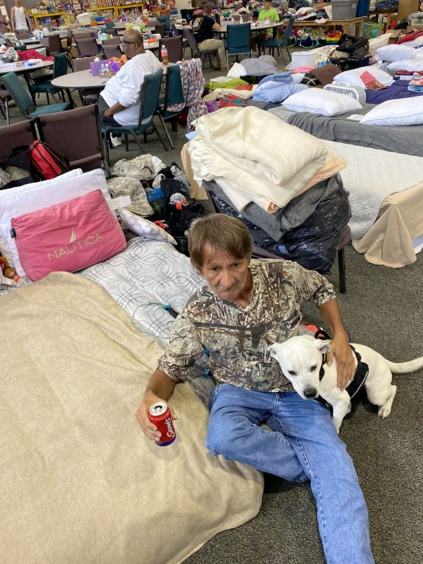 Thomas Erwin with his dog, Dundee, at the Waverly Church of Christ shelter.