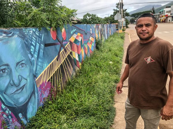 Elvis Tejeda of Predisan talks about a mural near the Good Samaritan Clinic depicting Ramon Navarro, a famous marimba player from Honduras. Navarro and his wife died six months apart from COVID-19.