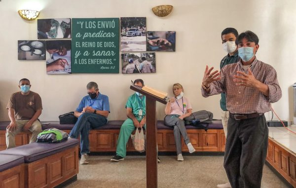 """During a Monday morning devotional, Julio Benitez thanks a surgical team for journeying to Predisan in Honduras in the midst of a global pandemic to serve those in need. """"Our God is happy with all of you,"""" he said through a translator."""