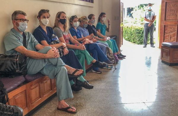 Members of a surgical team listen to a morning devotional from Julio Benitez before beginning a day of procedures at Predisan's Good Samaritan Clinic in Catacamas, Honduras.