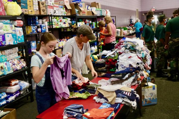 Volunteers sort donated clothes at the Waverly Church of Christ in Tennessee.