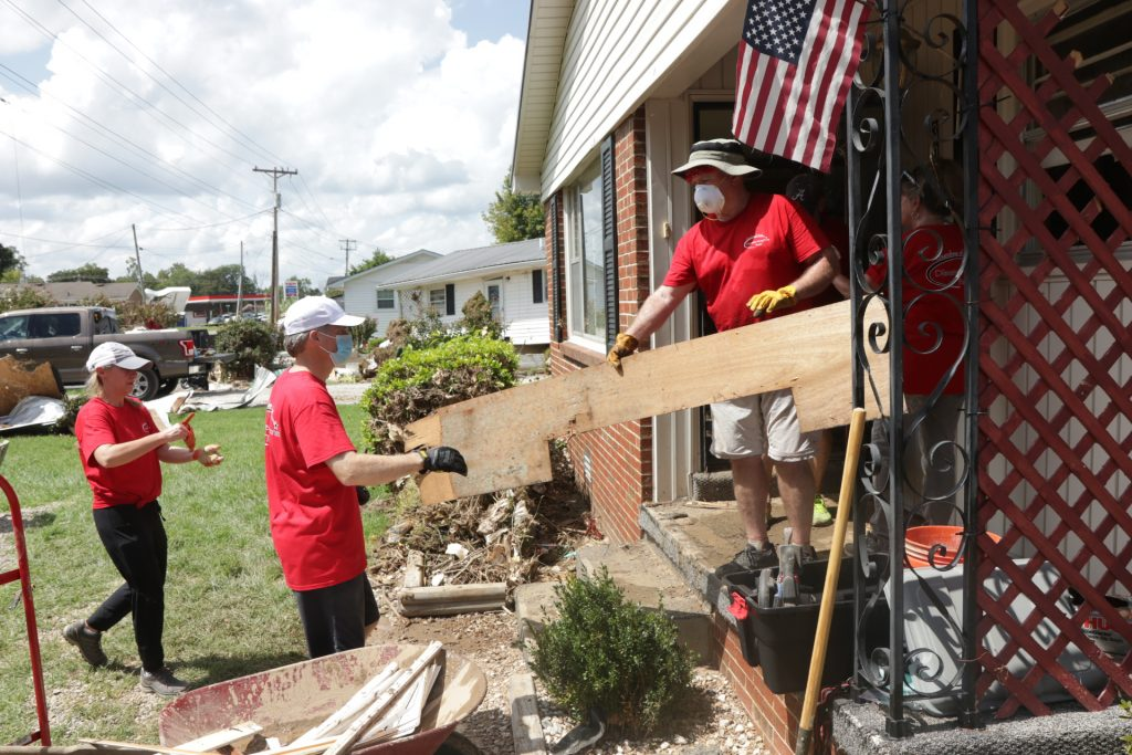 Volunteers with the Churches of Christ Disaster Response Team help with flood relief in Waverly, Tenn.