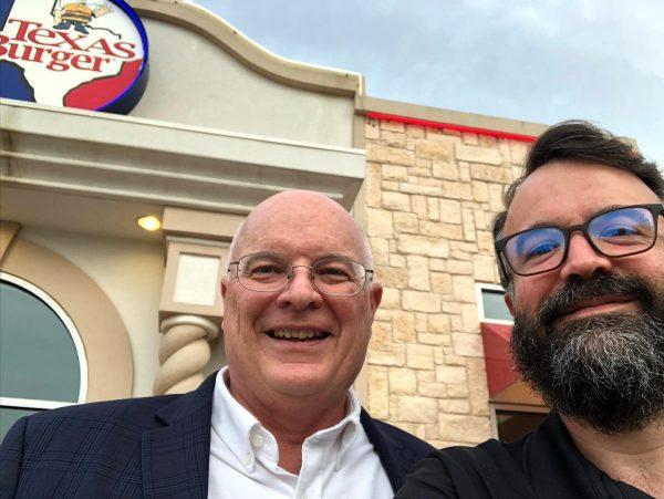 Erik Tryggestad and Westside Minister Mike Vestal eat at Texas Burger.