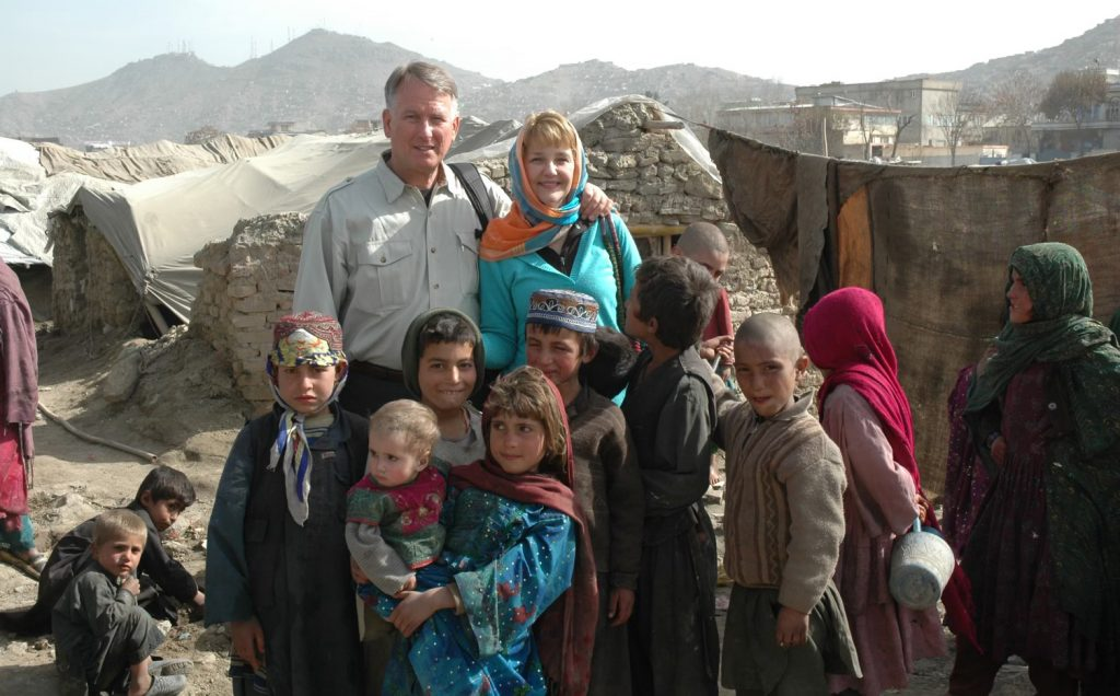 Retired Air Force Lt. Gen. John Bradley and his wife, Jan, in Kabul at an IDP (internally displaced persons) camp where they started a school.