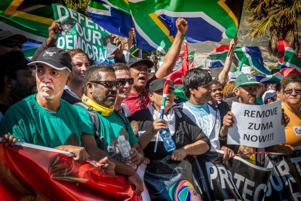 Protesters march to Parliament in Cape Town, South Africa, to demand that the President of South Africa, Jacob Zuma, step down immediately in April 2017. Zuma resigned in February 2018 after he was recalled by his own party, the ruling African National Congress (ANC).