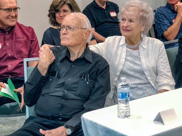 Lynn and Phyllis Huff react to a montage of photos of their time in Brazil. Behind them, far left, is Bryan Gibbs of Great Cities Missions.