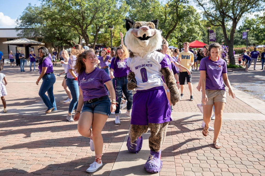 Students walk on the campus of Abilene Christian University.