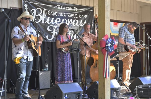 The bluegrass duo His & Hers, center, performs at Carolina Bible Camp's bluegrass festival Sept. 11. Sarah Davis (mandolin) and Caleb Davis (guitar) are members of the Jericho Church of Christ in Mocksville, N.C., next door to the camp.