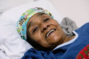 Alejandrina Castillo smiles while resting in the post-op recovery room.