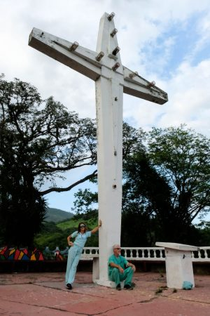 Ryan Dadds, left, and Dr. Chad Eustis, right, lean against a monumental cross in Catacamas, Honduras.